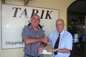 Tarik Presenting a Donation to The Rotary Club of Gibraltar